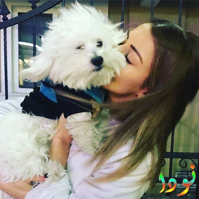 توغبا ميليس وكلبها