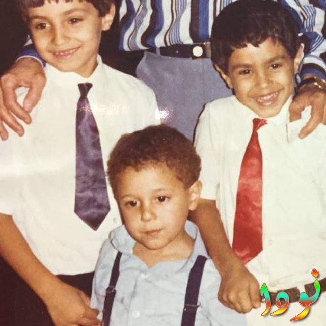 كريم فهمي وأخوه وهو صغير