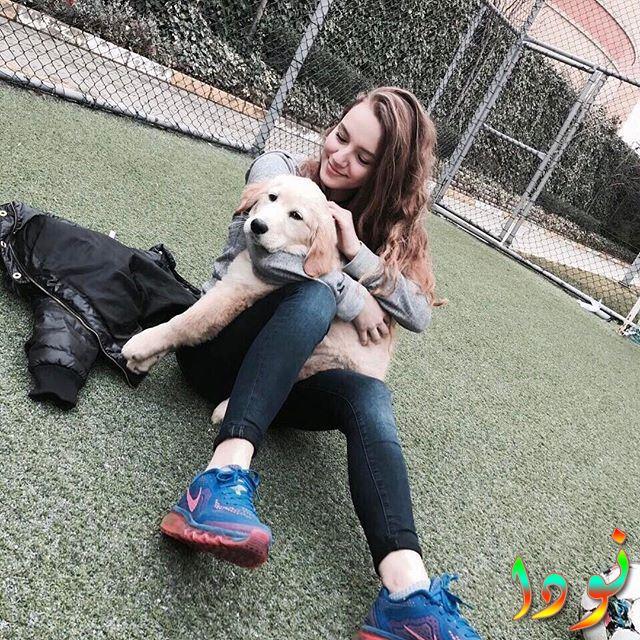 إسلم عكار مع كلبها
