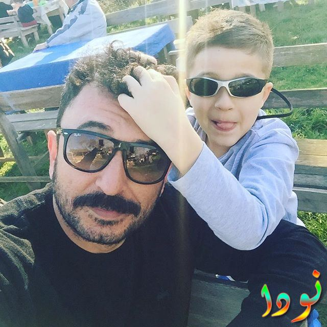 تويجان أفان أوغلو مع ابنه