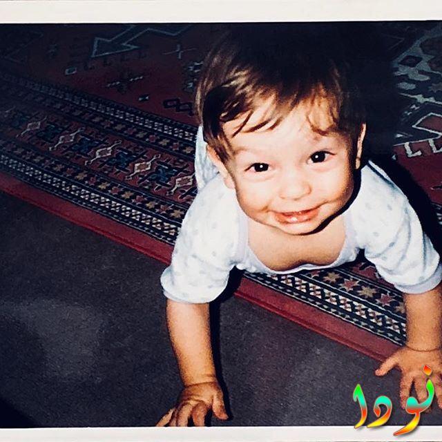 بوران كوزوم وهو طفل صغير