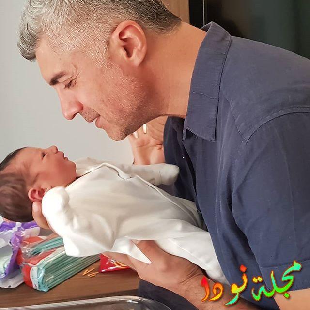 أوزجان دينيز وابنه الصغير