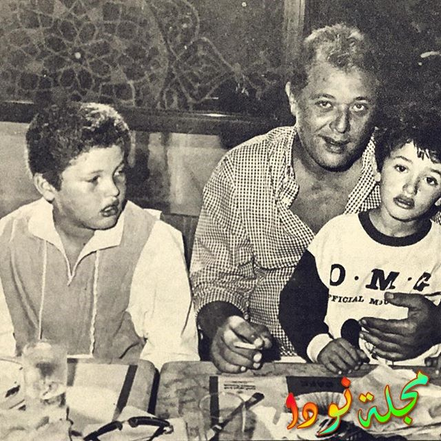 كريم محمود عبد العزيز مع والده وأخوه